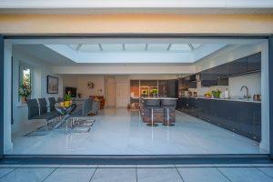 view of kitchen through bi-folding doors