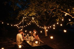 People eating outdoors at night