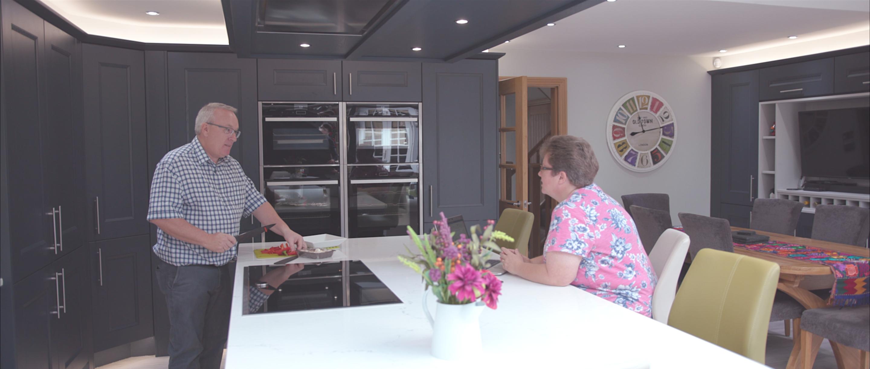 elderly couple in modern kitchen